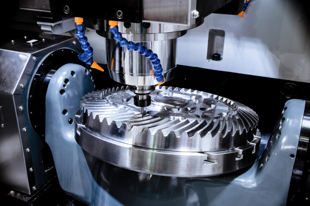 modern-cnc-milling-machine-makes-large-cogwheel_143715-6